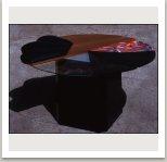 Stůl z různých materiálů (polstrování, sklo, plech, mramor, světlo, pomalované dřevo), 1983, 75x145x145 cm